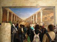 There's a tourist in this painting so you can't mistake it for an ancient one