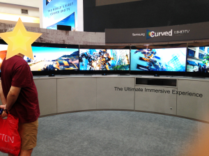 Dad, admiring a bank of Samsung Curved TVs